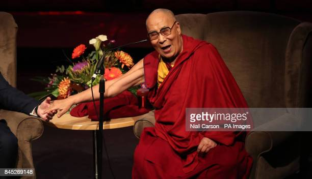 The Dalai Lama speaks at the Millennium Forum during a visit to Londonderry