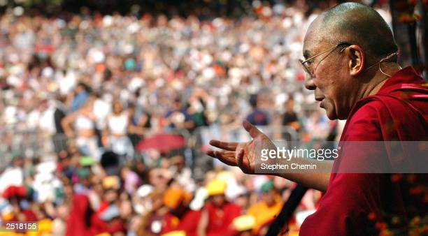 The Dalai Lama speaks during a free lecture in the east meadow of Central Park September 21 2003 in New York City The event was expected to draw an...