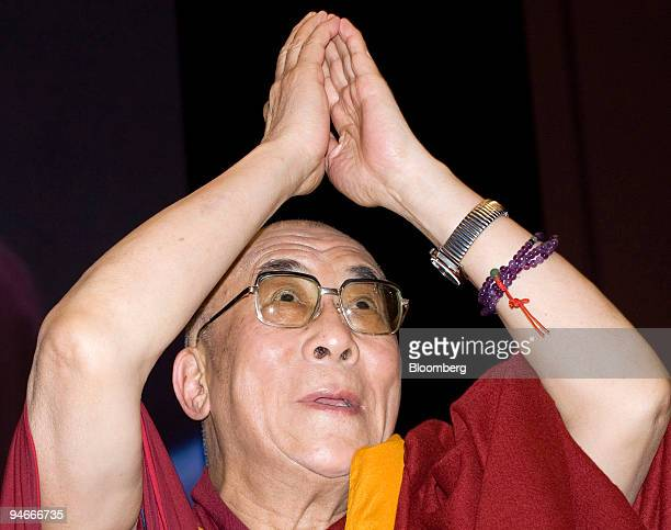 The Dalai Lama the spiritual leader of Tibet greets an audience at a conference hosted by the Japan Buddhist Federation in Yokohama City Japan on...