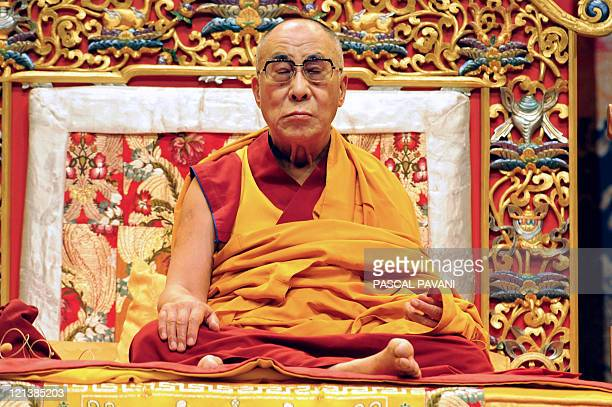 The Dalai Lama the Tibet's exiled spiritual leader sits during a conference on August 13 2011 at the Zenith of the French southwestern city of...