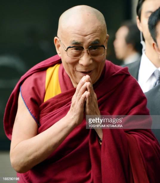 The Dalai Lama Tibet's spiritual leader greets wellwishers upon his arrival at Narita International airport in Narita near Tokyo on November 3 2012...