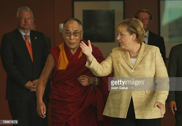 The Dalai Lama walks with German Chancellor Angela Merkel and Hessen Governor Roland Koch after private talks at the Chancellery September 23 2007 in...