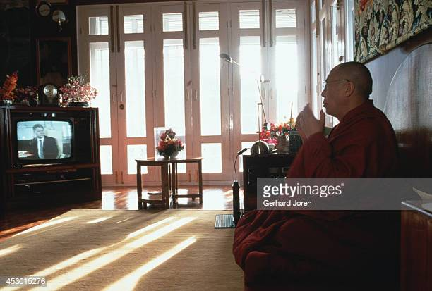 The Dalai Lama watching the news on the BBC after his morning meditation at his residence in McLeod Ganj