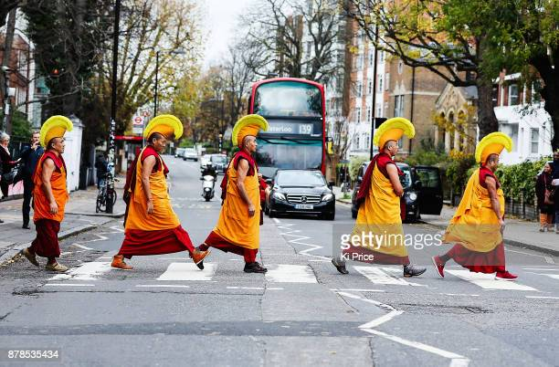 The Dalai Lama's Gyuto Monks walking across Abbey Road crossing ahead of their Open Minds Loving Heart Tour' on November 21 2017 in London England