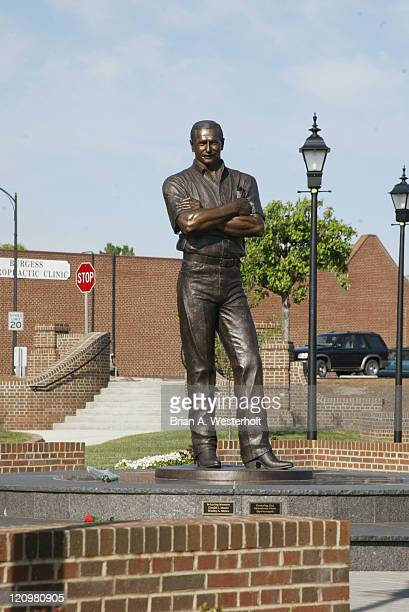 The Dale Earnhardt Tribute statue in downtown Kannapolis A few fans left flowers at the base of the statue on what would have been the Intimidator's...