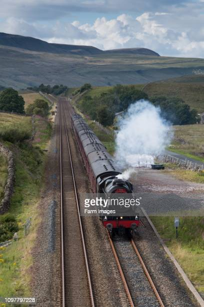 The Dalesman steam train pulling passenger carriages up the Aisgill Level on the Settle to Carlisle railway Cumbria UK