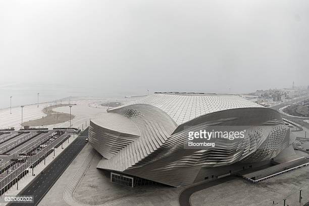 The Dalian International Conference Center stands in Dalian China on Tuesday Jan 17 2017 Contrasting fortunes in Dalian illustrate Chinas transition...