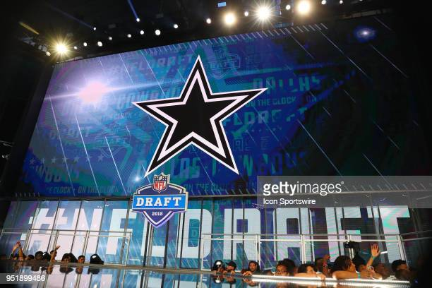 The Dallas Cowboy logo on the video board before the Dallas Cowboys make the 19th pick during the first round at the 2018 NFL Draft at AT&T Statium...