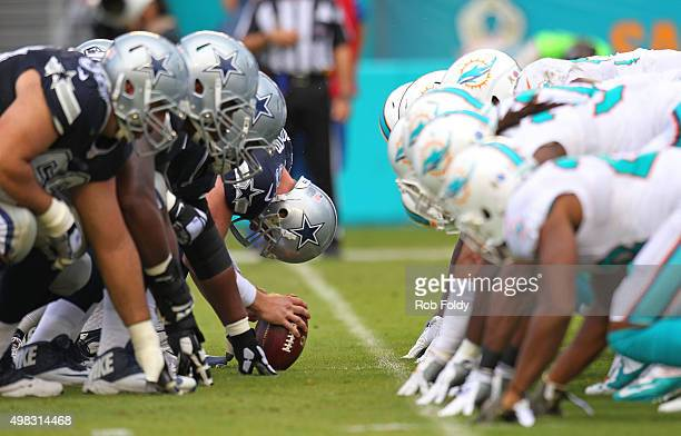 The Dallas Cowboys and Miami Dolphins line up before a snap during the first half of the game at Sun Life Stadium on November 22 2015 in Miami...