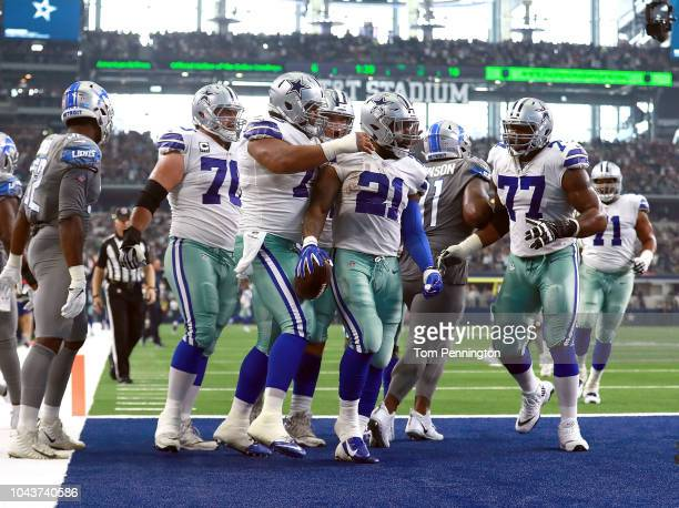 The Dallas Cowboys celebrate the secondquarter touchdown by Ezekiel Elliott in a game against the Detroit Lions at ATT Stadium on September 30 2018...