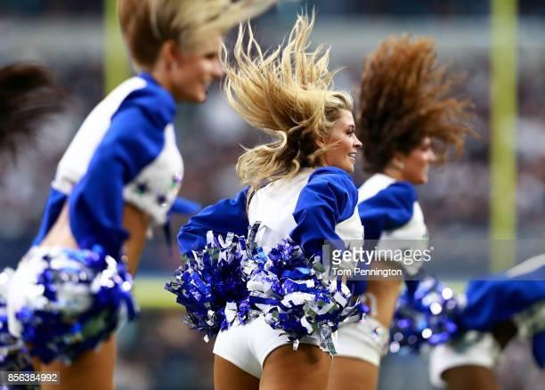 The Dallas Cowboys Cheerleaders perform as the Dallas Cowboys take on the Los Angeles Rams at ATT Stadium on October 1 2017 in Arlington Texas