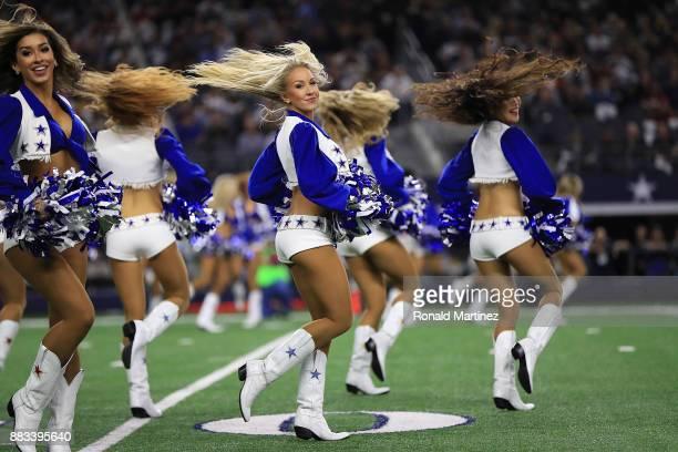 The Dallas Cowboys cheerleaders perform at ATT Stadium on November 30 2017 in Arlington Texas