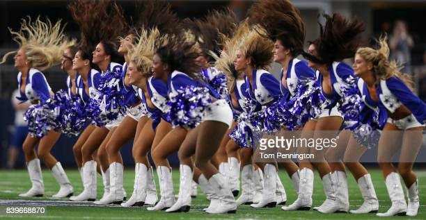 The Dallas Cowboys Cheerleaders perform before the Dallas Cowboys take on the Oakland Raiders in a Preseason game at ATT Stadium on August 26 2017 in...