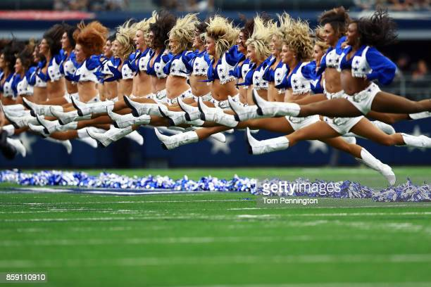 The Dallas Cowboys Cheerleaders perform before the Dallas Cowboys take on the Green Bay Packers at ATT Stadium on October 8 2017 in Arlington Texas