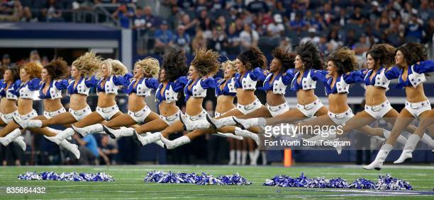 The Dallas Cowboys Cheerleaders perform before the first half of a preseason game against the Indianapolis Colts at ATT Stadium in Arlington Texas on...