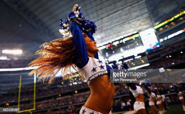 The Dallas Cowboys Cheerleaders perform during a Thanksgiving Day game at ATT Stadium on November 28 2013 in Arlington Texas The Dallas Cowboys beat...