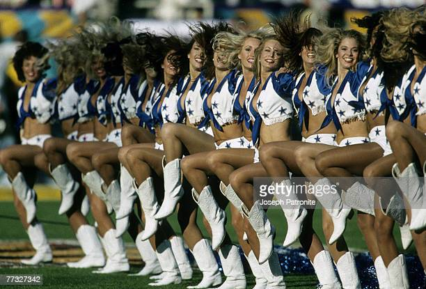 The Dallas Cowboys Cheerleaders perform during the Cowboys 2717 victory over the Pittsburgh Steelers in Super Bowl XXX on January 28 1996 at Sun...