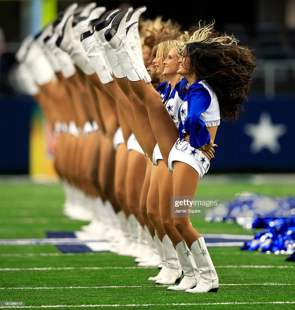 The Dallas Cowboys cheerleaders perform during the game against the St. Louis Rams at AT&T Stadium on September 22, 2013 in Arlington, Texas.