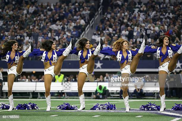 The Dallas Cowboys cheerleaders perform on the field prior to the NFC Divisional Playoff game against the Green Bay Packers at ATT Stadium on January...