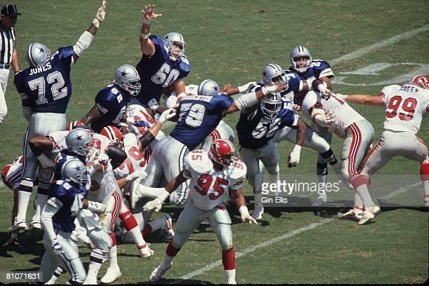 The Dallas Cowboys defense tries to block a kick against the Atlanta Falcons in Atlanta FultonCounty Stadium on September 17 1989 in Atlanta Georgia...