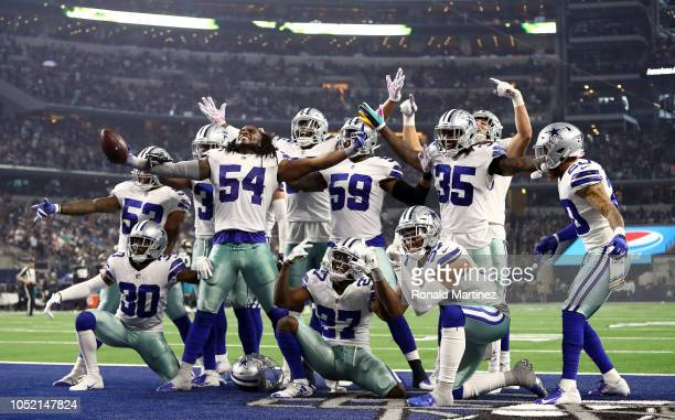 The Dallas Cowboys defensive line celebrates a fumble recovery against the Jacksonville Jaguars in the third quarter of a game at AT&T Stadium on...