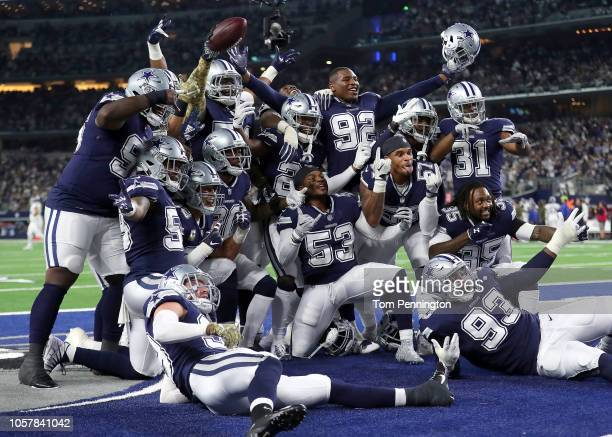 The Dallas Cowboys defensive line poses for a photo in the end zone after a fumble recovery against the Tennessee Titans in the first quarter of a...