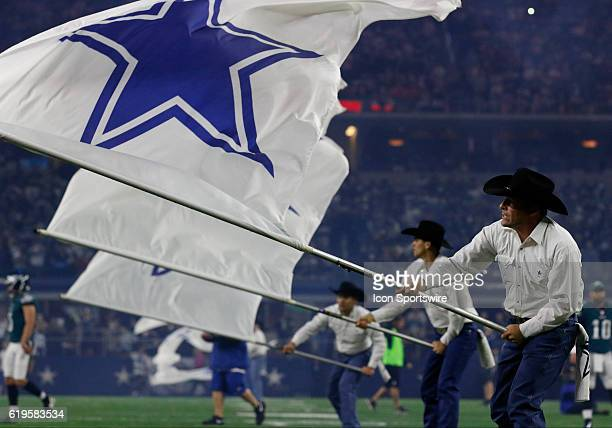 The Dallas Cowboys flag crew waves their flags prior to a NFL game between the Dallas Cowboys and the Philadelphia Eagles on October 30 at ATT...