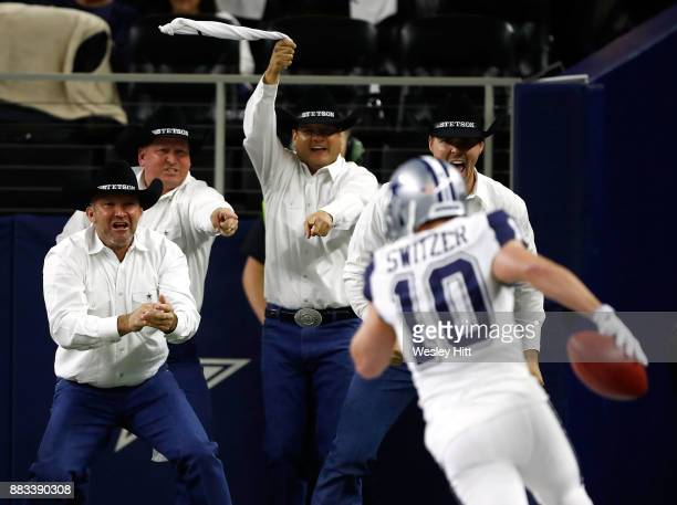 The Dallas Cowboys Flag Runners react to the 83yard punt return touchdown by Ryan Switzer of the Dallas Cowboys in the second quarter of a football...