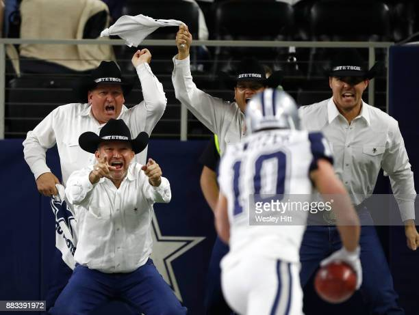 The Dallas Cowboys Flag Runners react to the 83yard punt return by Ryan Switzer of the Dallas Cowboys in the second quarter of a football game...