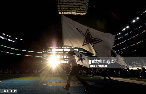 The Dallas Cowboys flag team runs on the field after a touchdown against the Los Angeles Rams in the second quarter at AT&T Stadium on December 15,...
