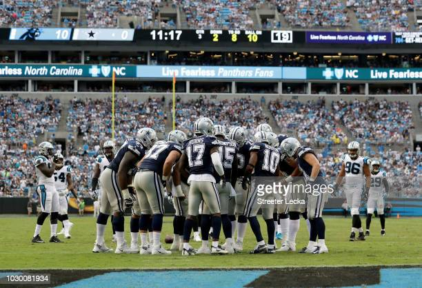 The Dallas Cowboys huddle against the Carolina Panthers in the fourth quarter during their game at Bank of America Stadium on September 9 2018 in...