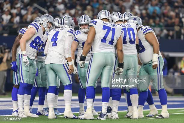 The Dallas Cowboys huddle during the game between the Dallas Cowboys and the Philadelphia Eagles on December 9 2018 at ATT Stadium in Arlington Texas