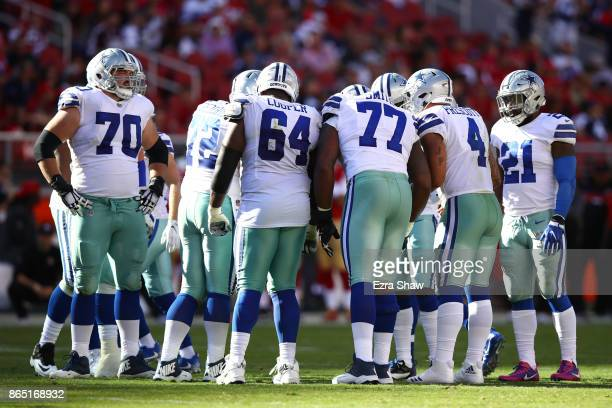 The Dallas Cowboys huddle during their NFL game against the San Francisco 49ers at Levi's Stadium on October 22 2017 in Santa Clara California