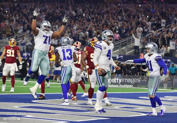 The Dallas Cowboys including La'el Collins and Cole Beasley celebrate the fourth quarter touchdown by Dak Prescott against the Washington Redskins at...