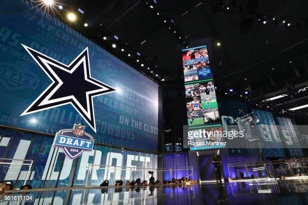 The Dallas Cowboys logo is seen on a video board during the first round of the 2018 NFL Draft at AT&T Stadium on April 26, 2018 in Arlington, Texas.