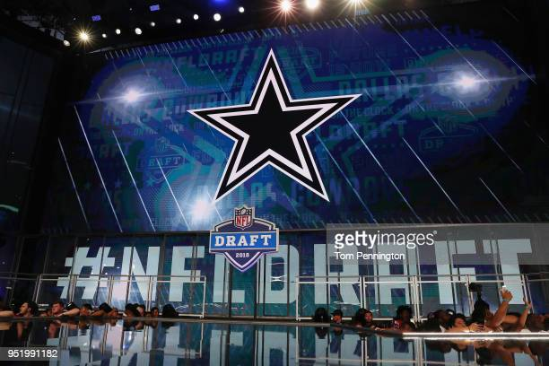 The Dallas Cowboys logo is seen on a video board during the first round of the 2018 NFL Draft at ATT Stadium on April 26 2018 in Arlington Texas