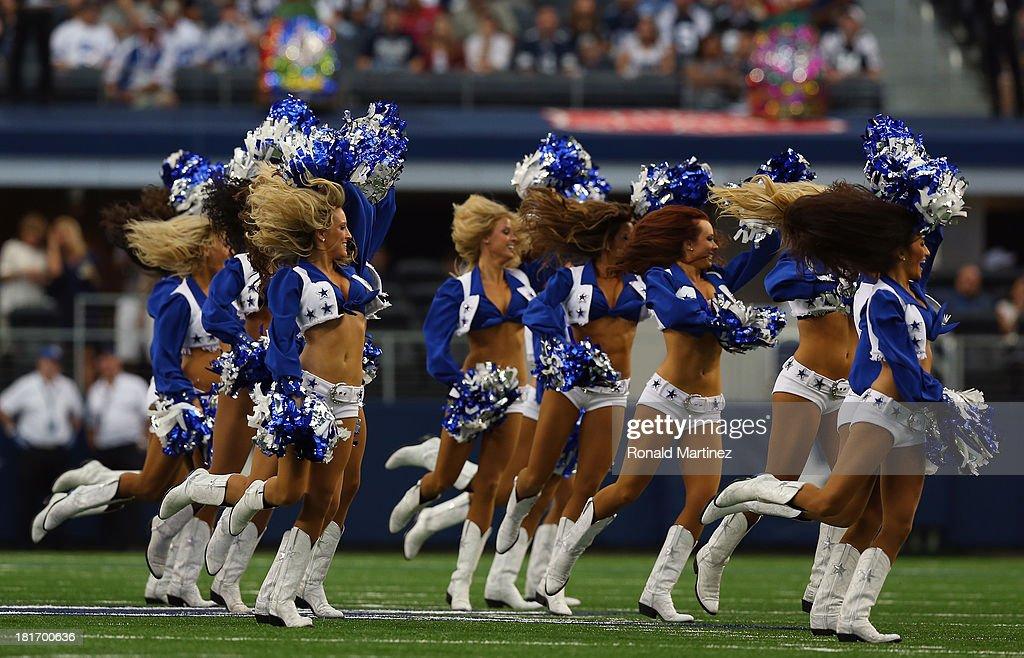 The Dallas Cowboys perform at AT&T Stadium on September 22, 2013 in Arlington, Texas.