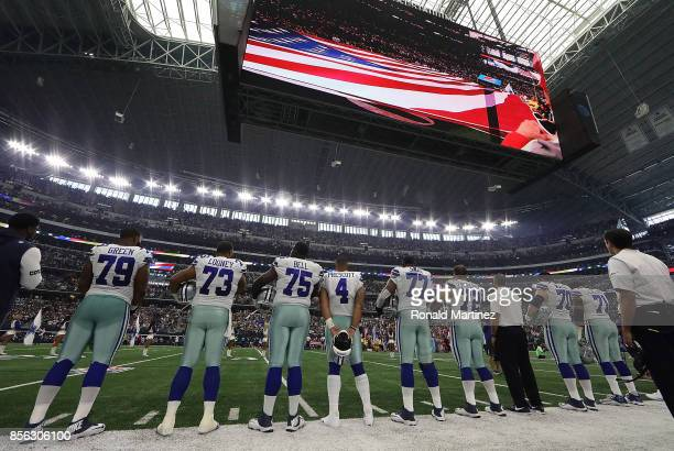 The Dallas Cowboys stand during the National Anthem before play against the Los Angeles Rams at ATT Stadium on October 1 2017 in Arlington Texas