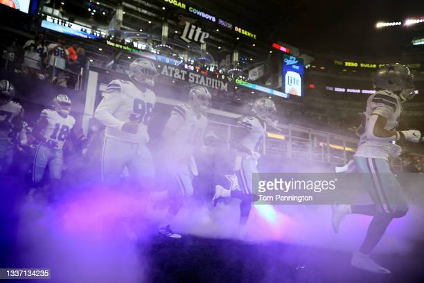 The Dallas Cowboys take the field agains the Jacksonville Jaguars during a NFL preseason game at AT&T Stadium on August 29, 2021 in Arlington, Texas.