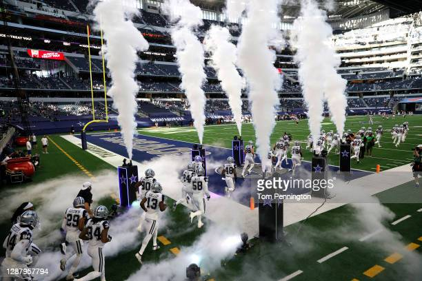 The Dallas Cowboys take the field prior to facing the Washington Football Team at AT&T Stadium on November 26, 2020 in Arlington, Texas.