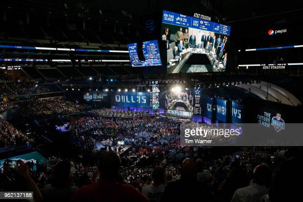 The Dallas Cowboys war room is seen on a video board during the first round of the 2018 NFL Draft at ATT Stadium on April 26 2018 in Arlington Texas