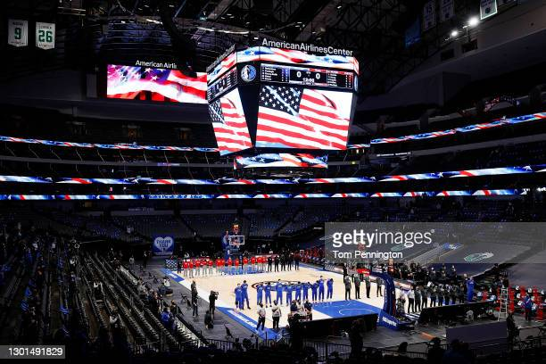 The Dallas Mavericks and the Atlanta Hawks stand for the National Anthem prior to tipoff of their NBA game at American Airlines Center on February...