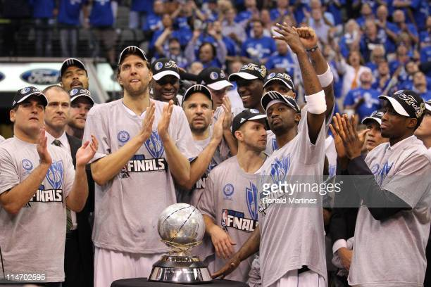 The Dallas Mavericks celebrate their 10096 victory against the Oklahoma City Thunder in Game Five of the Western Conference Finals during the 2011...