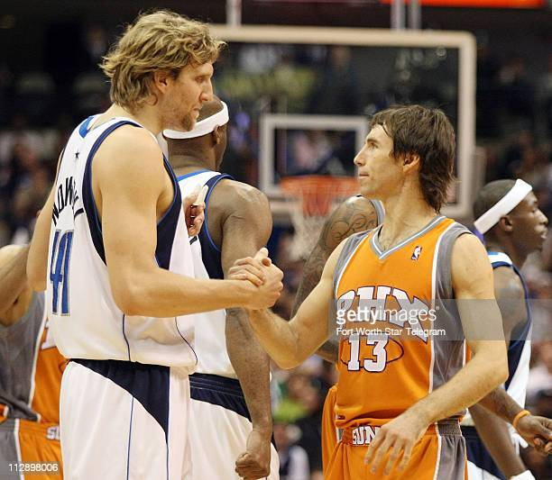 The Dallas Mavericks' Dirk Nowitzki greets Phoenix Suns guard Steve Nash before the game at the American Airlines Center in Dallas Texas Wednesday...