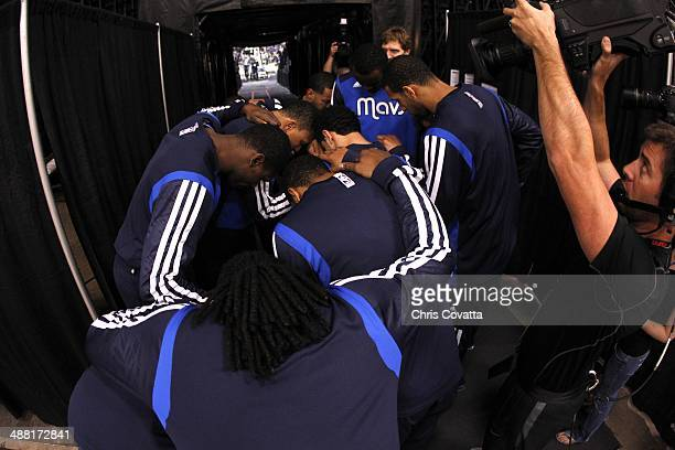 The Dallas Mavericks huddle in the tunnel before playing the San Antonio Spurs in Game Seven of the Western Conference Quarterfinals during the 2014...