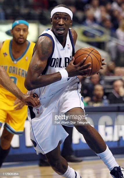 adc8dd0e32a4 The Dallas Mavericks  Josh Howard drives against the New Orleans Hornets  defense during first quarter