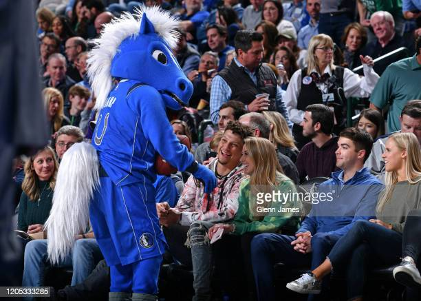 The Dallas Mavericks mascot interacts with Chiefs quarterback Patrick Mahomes during the game between the New Orleans Pelicans and the Dallas...