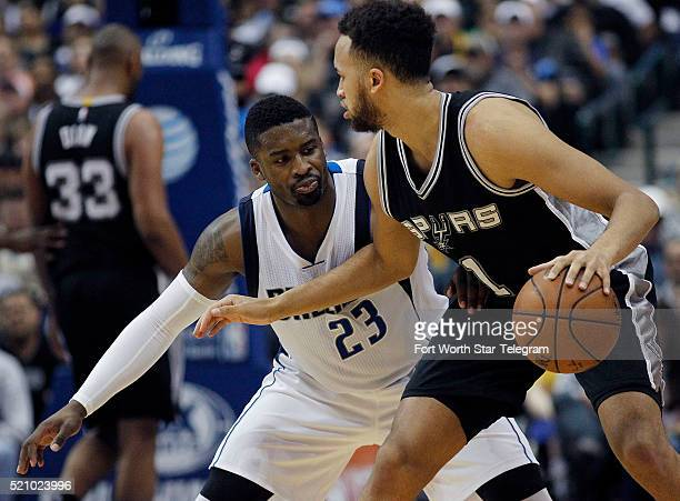 The Dallas Mavericks' Wesley Matthews guards the San Antonio Spurs' Kyle Anderson in the third period on Wednesday April 13 at the American Airlines...
