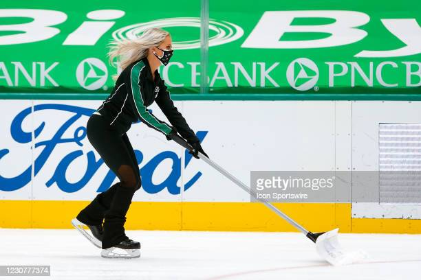 The Dallas Stars Ice Girls clean the ice during the game between the Nashville Predators and Dallas Stars on January 24, 2021 at American Airlines...