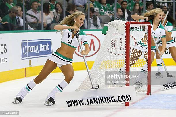 The Dallas Stars Ice Girls clean the surface during the NHL game between the Anaheim Ducks and Dallas Stars at American Airlines Center in Dallas TX...